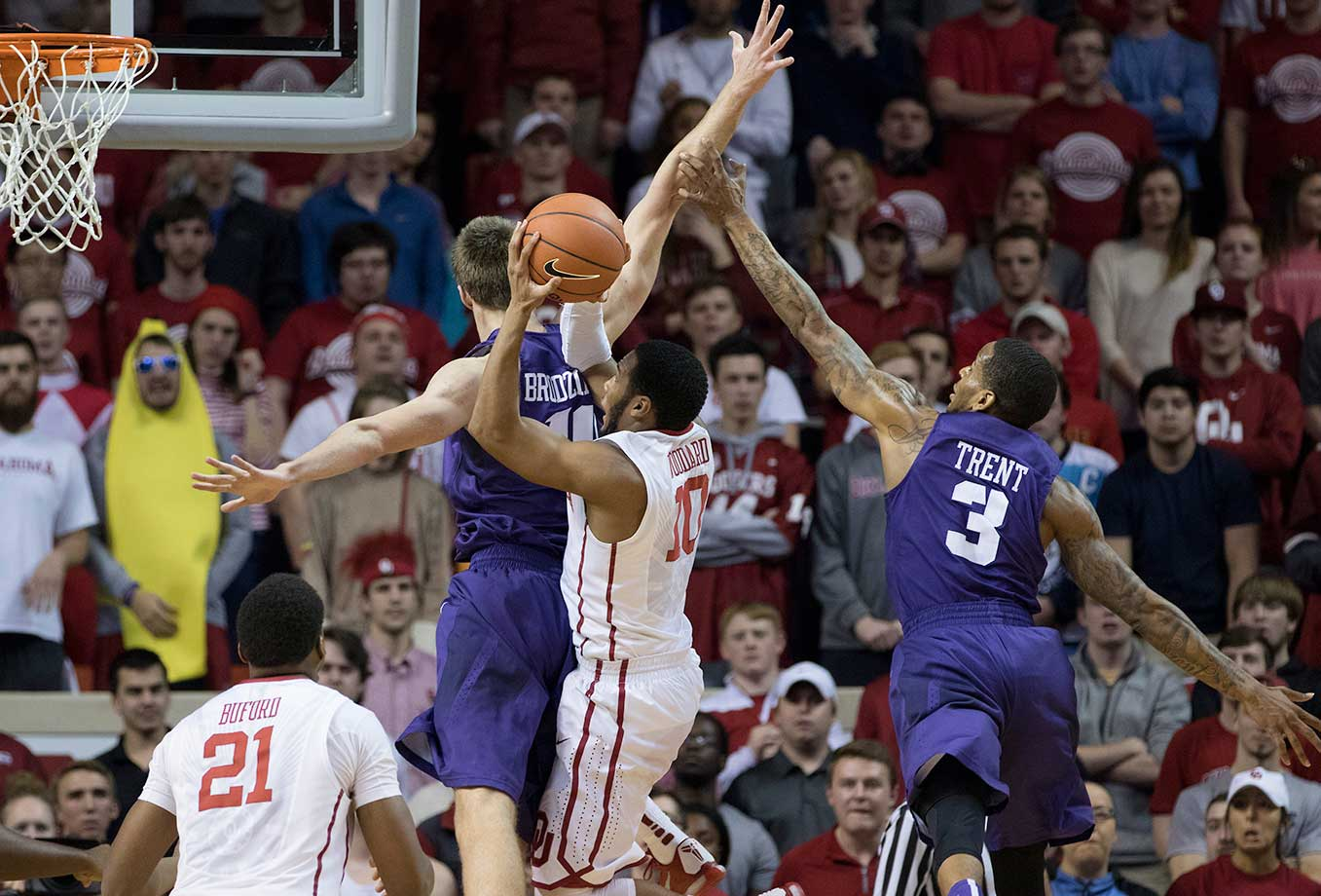 Vladimir Brodziansky and Malique Trent of the TCU Horned Frogs defend against Jordan Woodard of the Oklahoma Sooners at the Lloyd Noble Center in Norman, Okla.