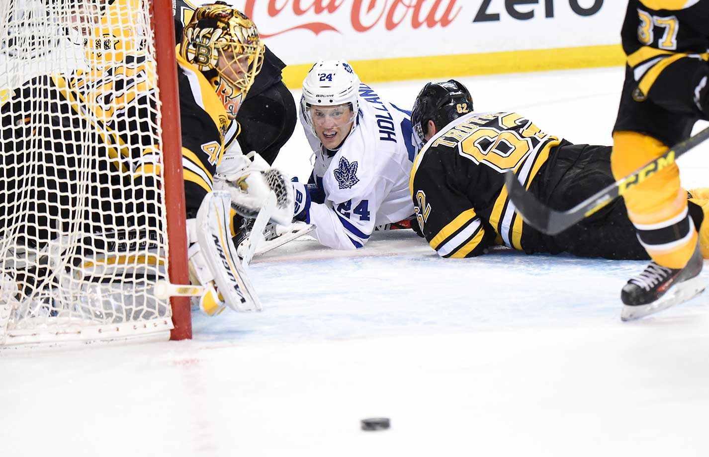 Peter Holland (24) of the Toronto Maple Leafs watches the loose puck against the Boston Bruins at the TD Garden in Boston.