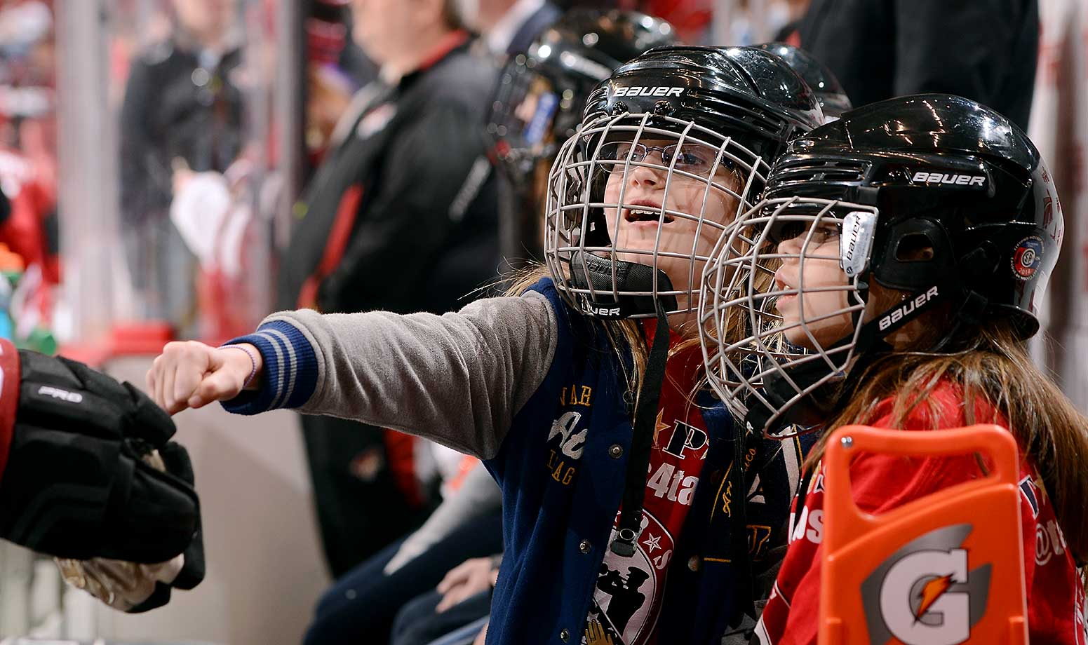 A youth hockey player fist bumps a Coyotes player before the start of the game between Arizona and the Los Angeles Kings at Gila River Arena in Glendale, Ariz.