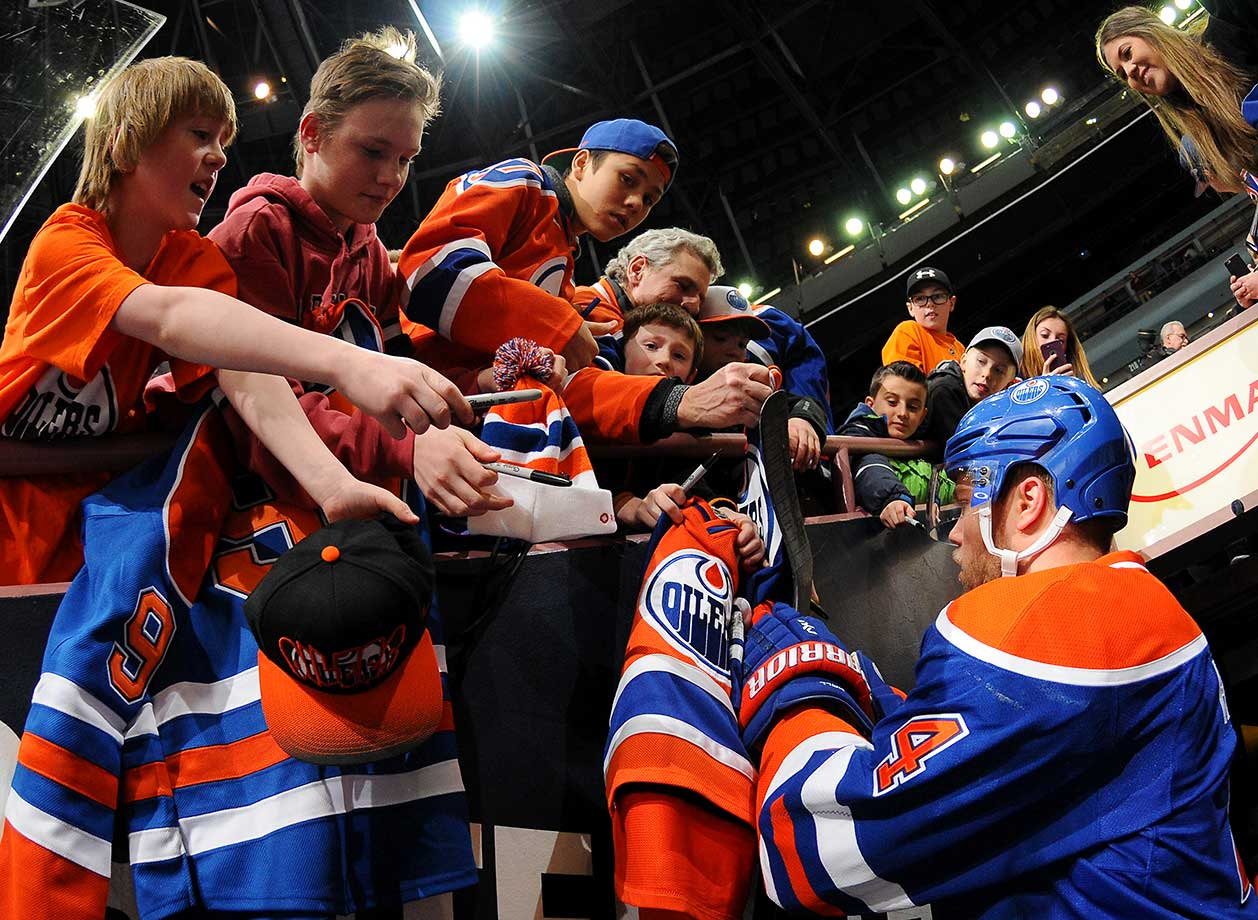 Taylor Hall of the Edmonton Oilers signs autographs for fans prior to a game against the Columbus Blue Jackets at Rexall Place in Alberta, Canada.