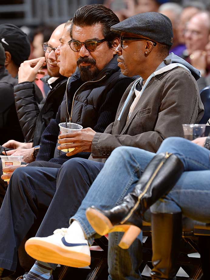 Comedian George Lopez and Arsenio Hall enjoy the Los Angeles Lakers against the Minnesota Timberwolves at Staples Center in Los Angeles.