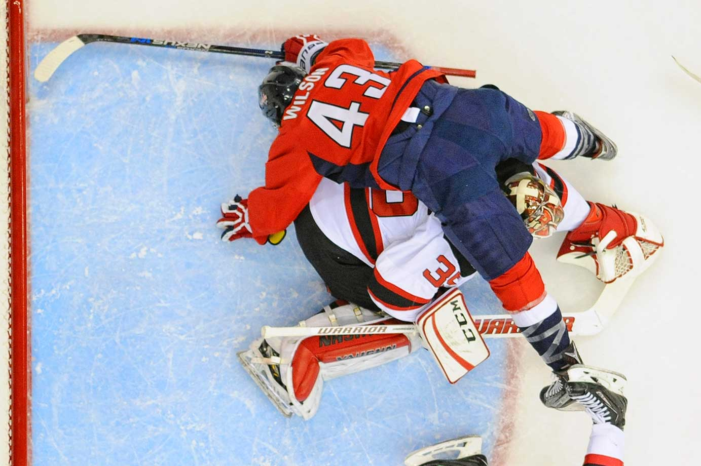 Washington right wing Tom Wilson (43) crashes into New Jersey Devils goalie Cory Schneider.