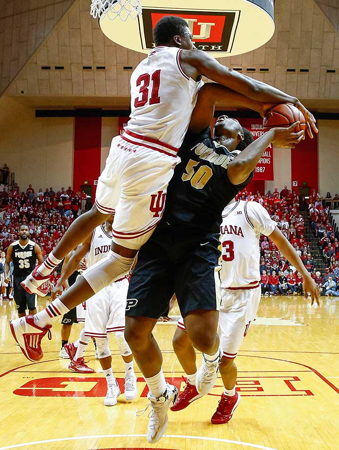 Thomas Bryant of the Indiana Hoosiers blocks the shot of Caleb Swanigan of the Purdue Boilermakers.