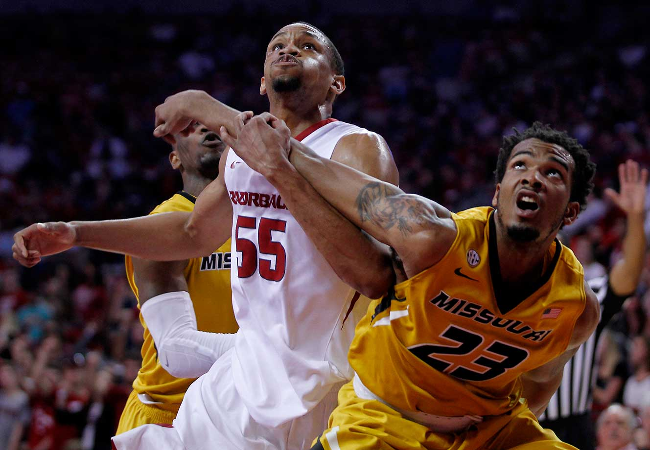 Arkansas' Keaton Miles (55) and Missouri's Jakeenan Gant (23) fight before rebounding a free throw.