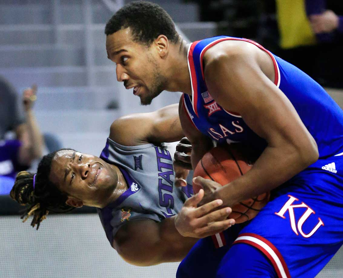 Kansas guard Wayne Selden Jr., right, wrestles the ball away from Kansas State forward D.J. Johnson.
