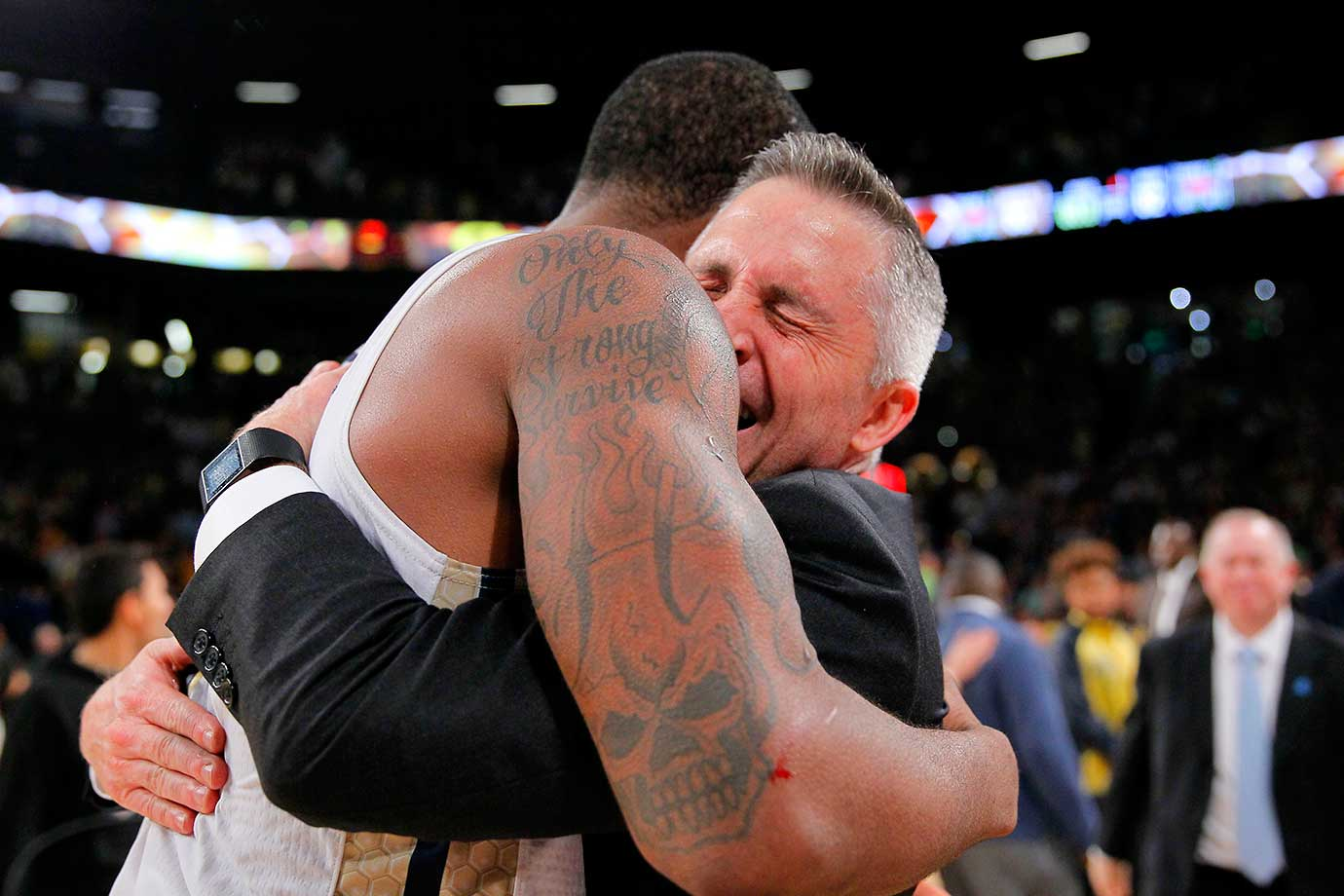 Georgia Tech coach Brian Gregory celebrates with guard Marcus Georges-Hunt after a 63-62 win over Notre Dame in Atlanta.