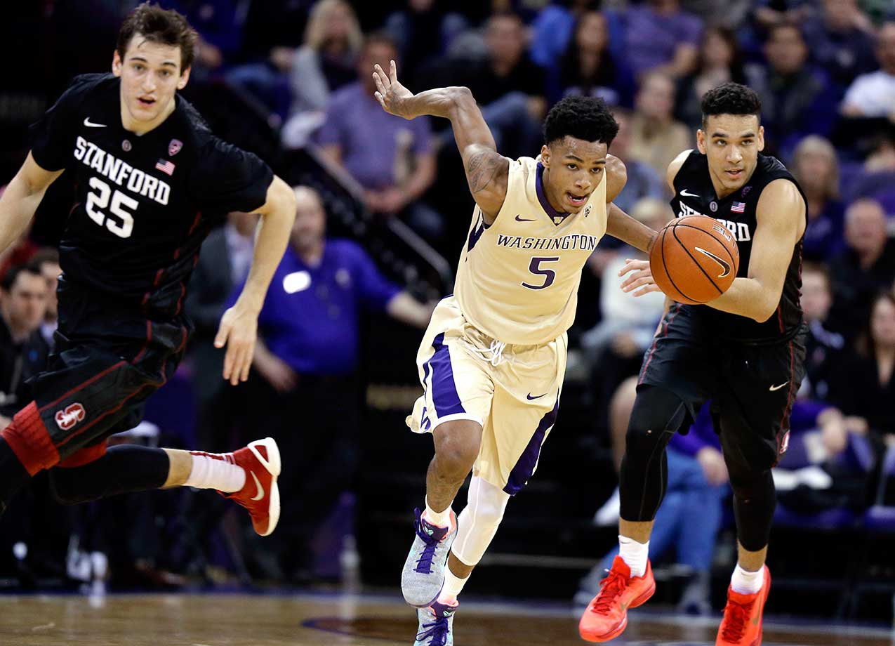 Washington guard Dejounte Murray takes off on a fast break next to Stanford's Rosco Allen (25) and Dorian Pickens.