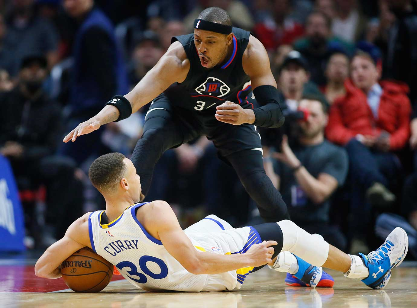 Paul Pierce gets set to dive for the ball after Steph Curry fell while dribbling behind his back. Pierce was called for a foul.