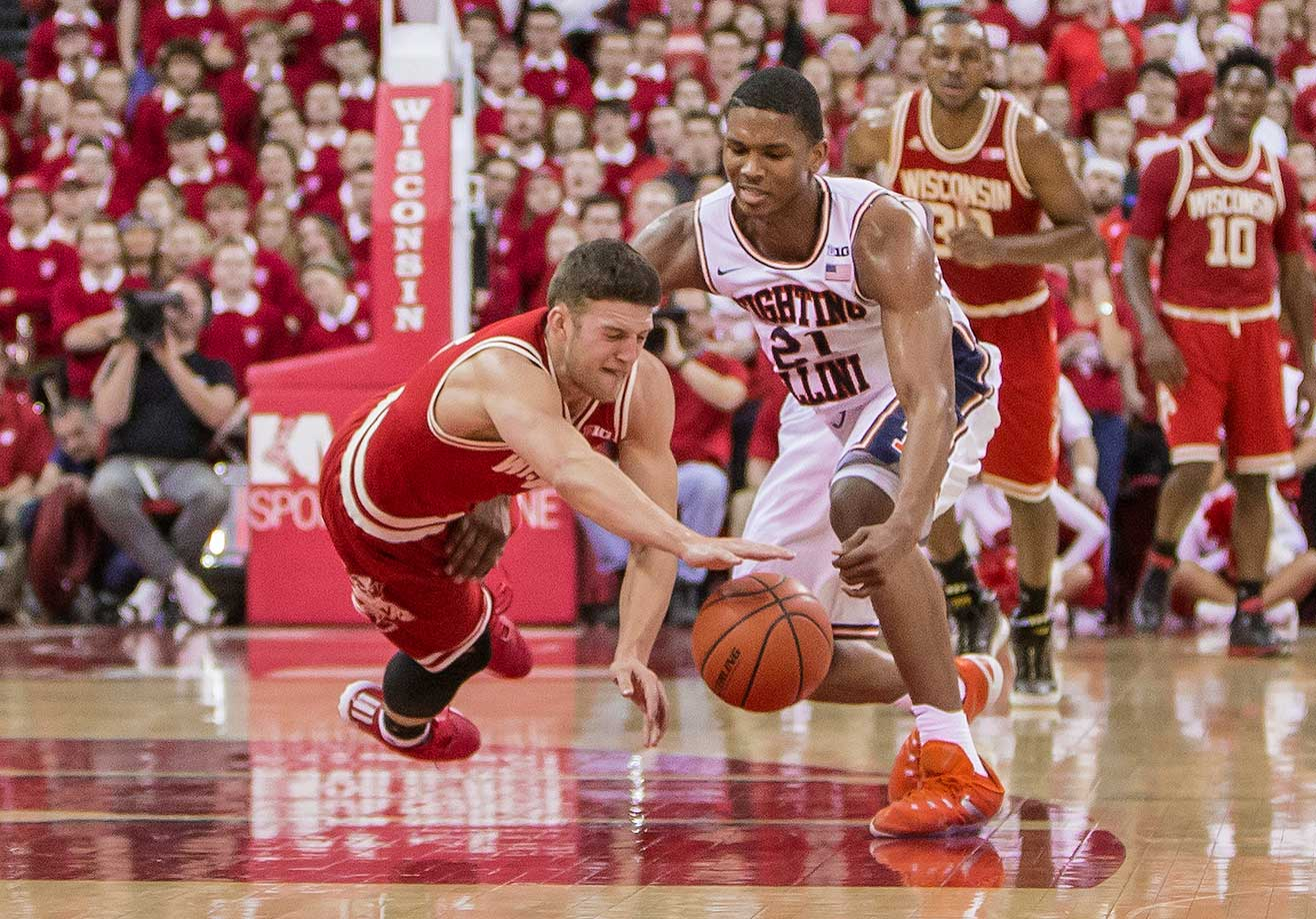 Wisconsin guard Zak Showalter dives for a loose ball during a come-from-behind win over Illinois.