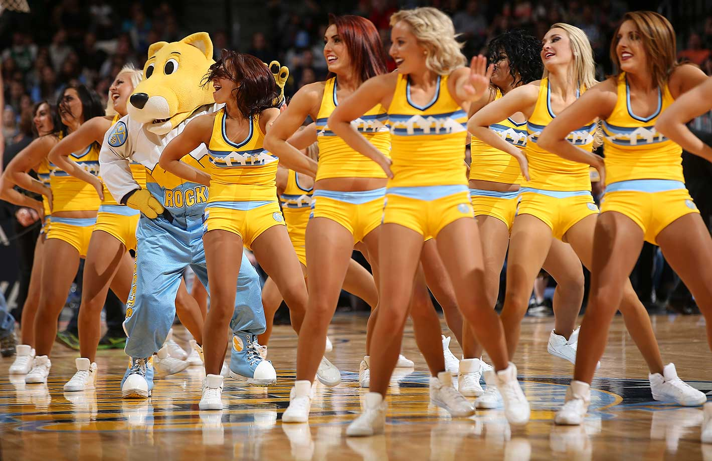 Super Mascot Rocky performs with the Denver Nuggets Dancers.