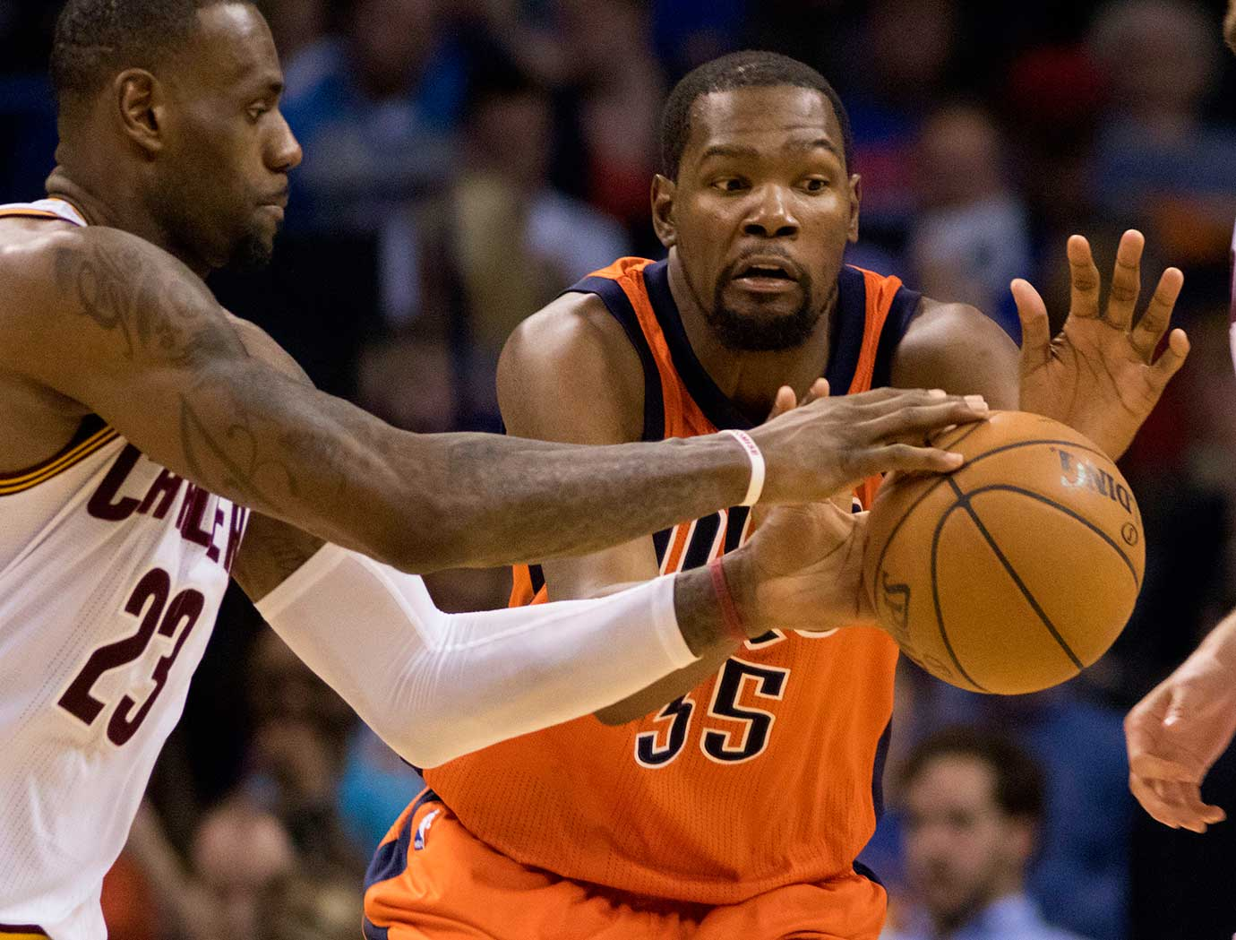 Kevin Durant of the Oklahoma City Thunder tries to keep the ball away from LeBron James.