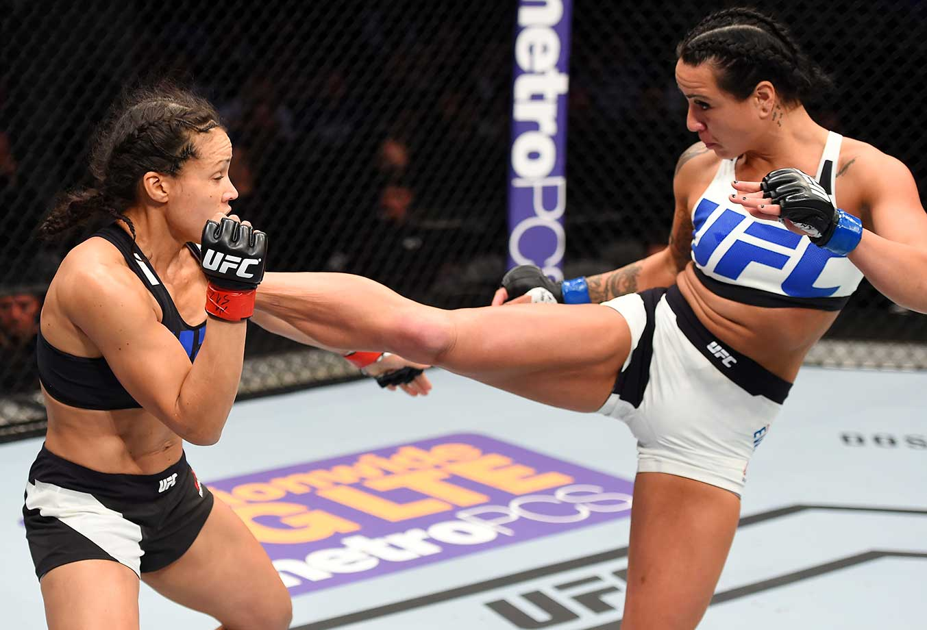 Ashlee Evans-Smith kicks Marion Reneau in their bantamweight bout during the UFC Fight Night in Pittsburgh.