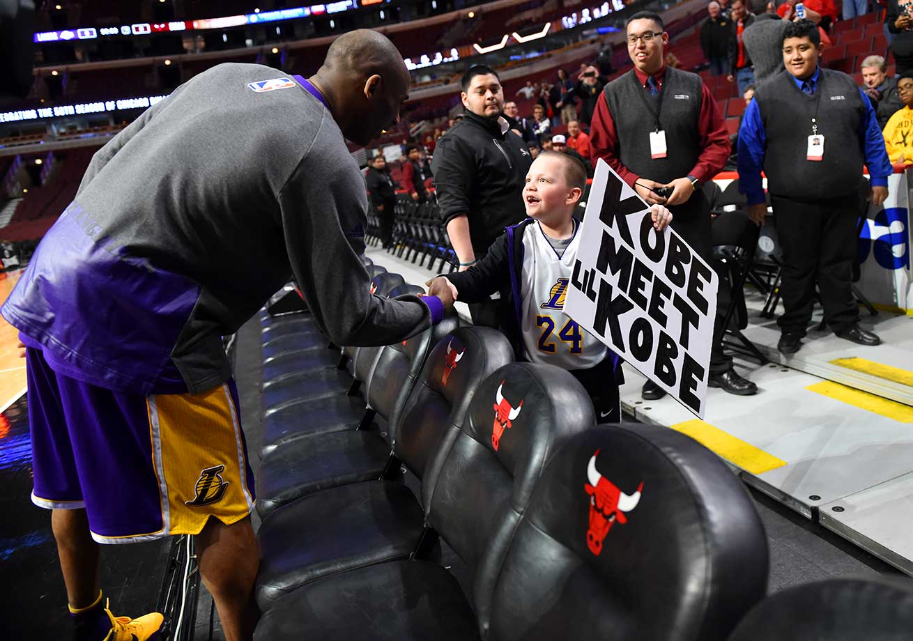 Kobe Bryant meets a young fan prior to a game at the Chicago Bulls.
