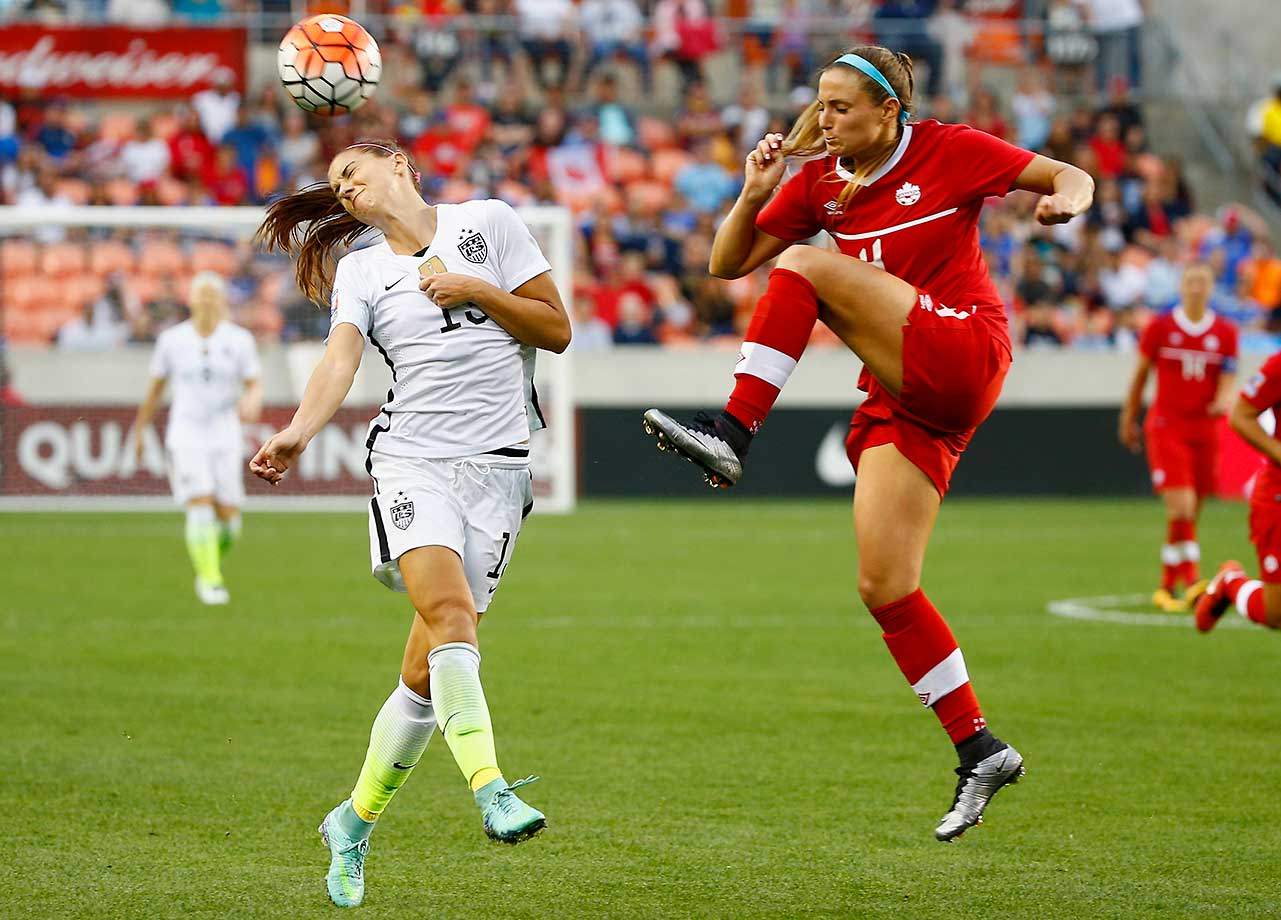 Alex Morgan of the U.S. battles for the ball with Shelina Zadorsky of Canada during the championship final of an Olympic qualifying tournament.