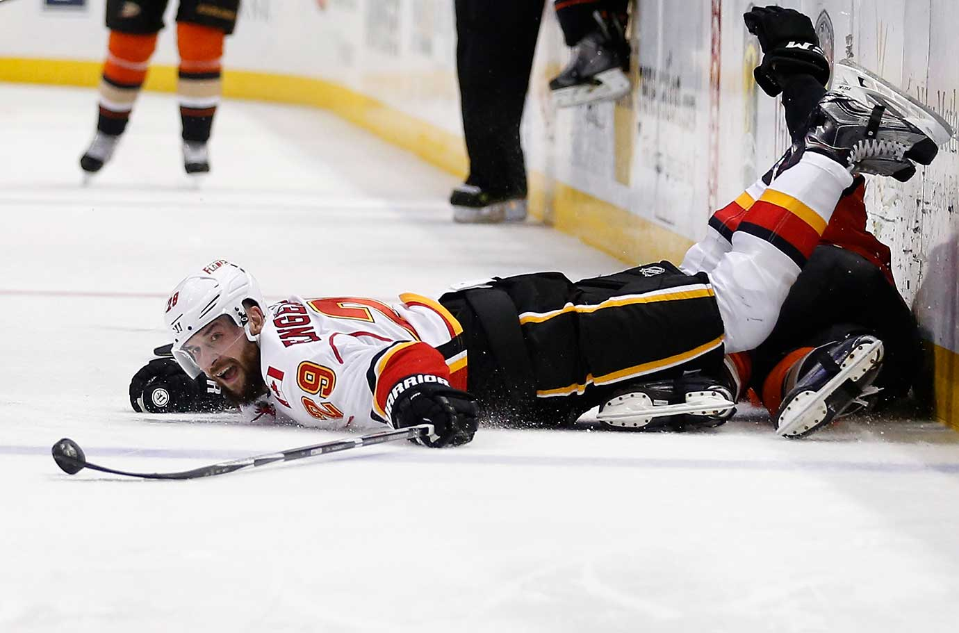 Deryk Engelland of Calgary lunges for a loose puck against the Anaheim Ducks.