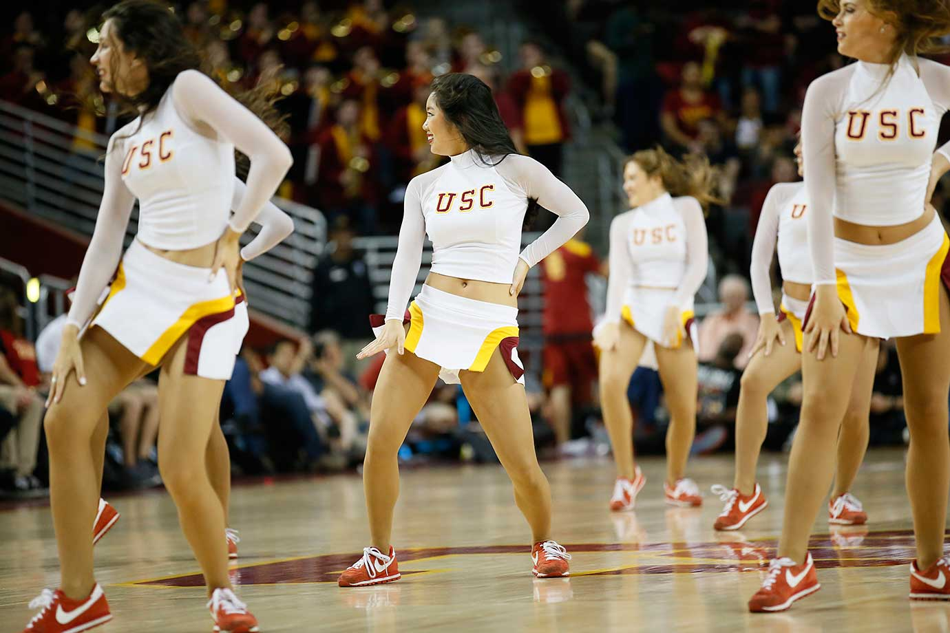 The Southern California song girls cheerleaders perform during a break between USC and Utah.