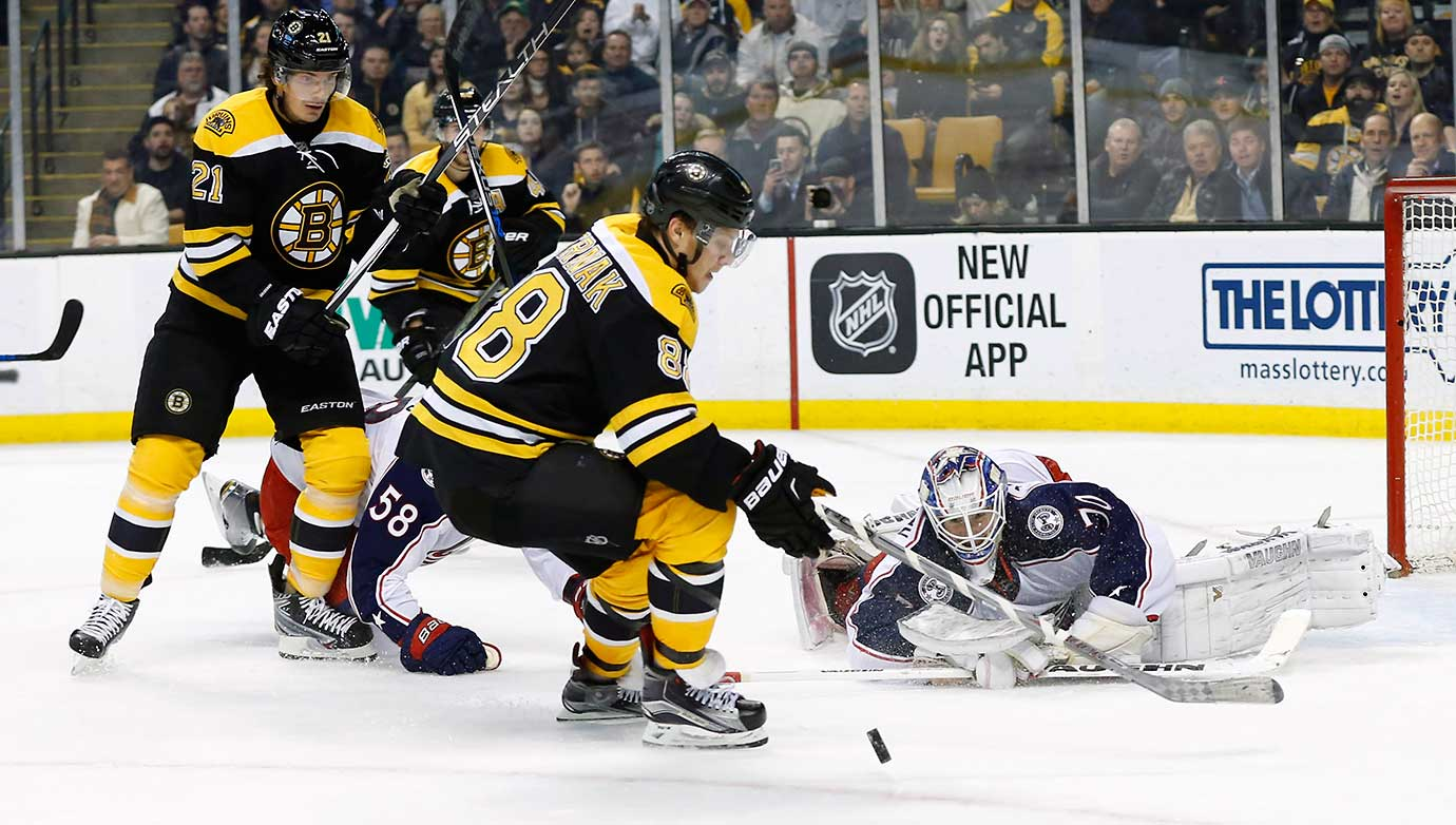 Columbus goalie Joonas Korpisalo makes the save on Boston Bruins right wing David Pastrnak.