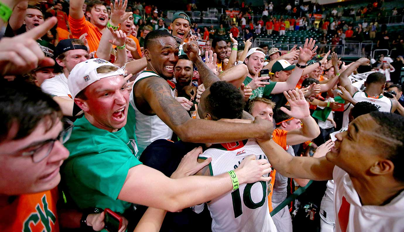 Miami Hurricanes players celebrate after defeating the visiting Virginia Cavaliers.