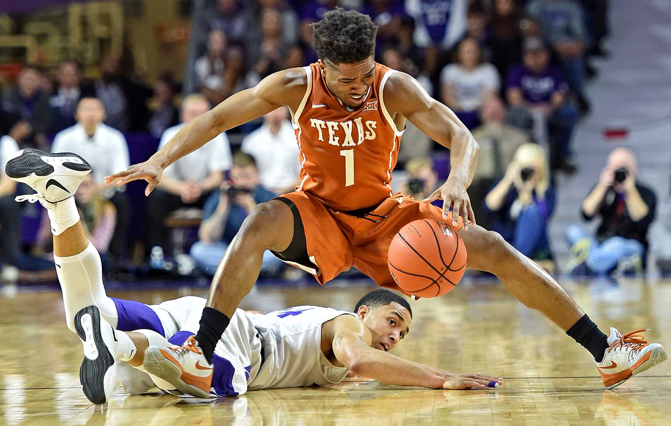 Isaiah Taylor of the Texas Longhorns scrambles for a loose ball against Justin Edwards of Kansas State.