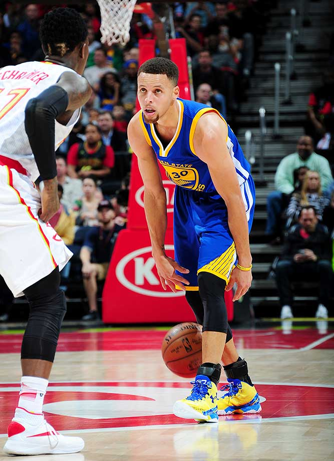 Stephen Curry of the Golden State Warriors deftly handles the ball against the Atlanta Hawks.