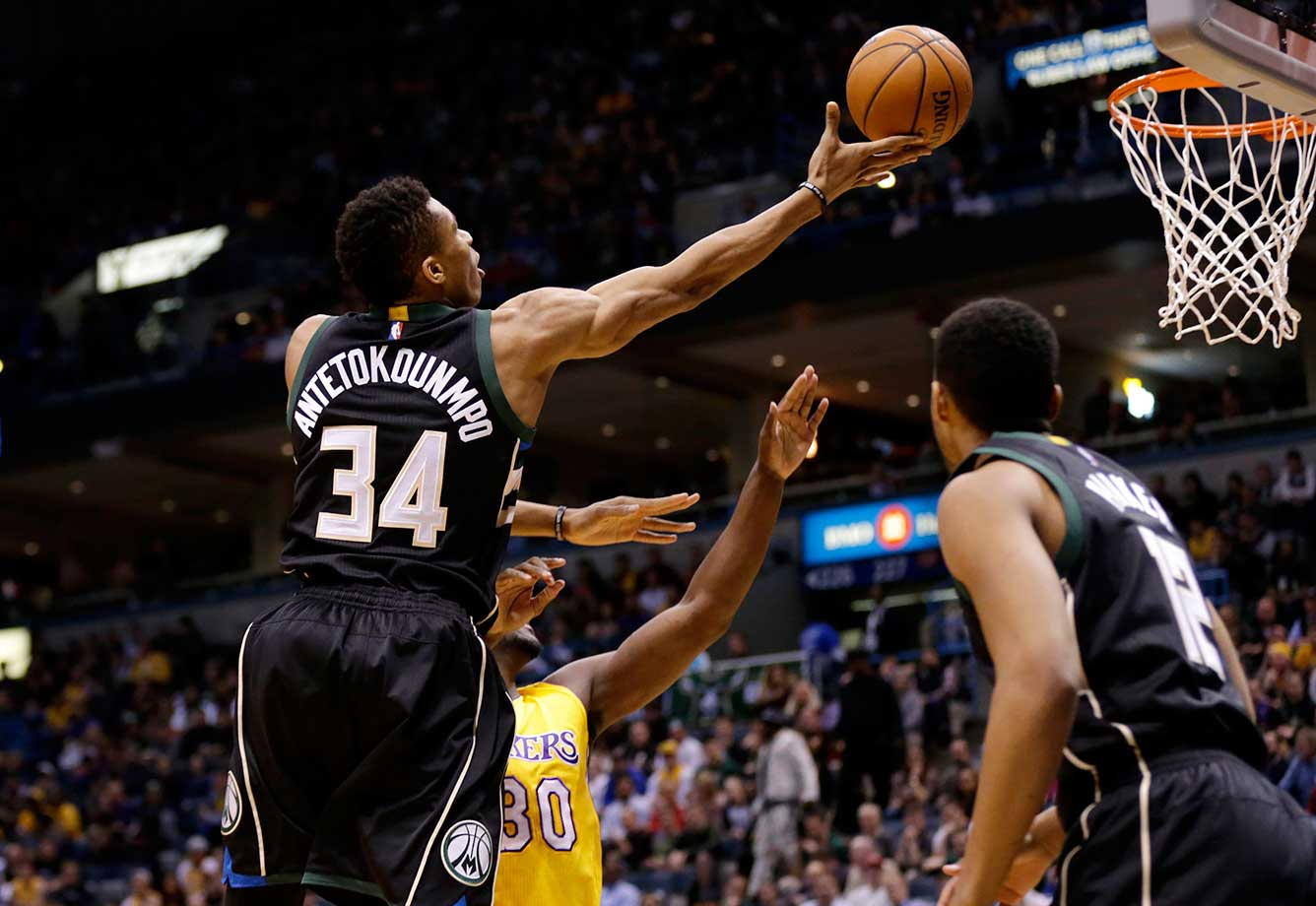 Giannis Antetokounmpo of the Milwaukee Bucks drives to the hoop for two points against the Los Angeles Lakers.