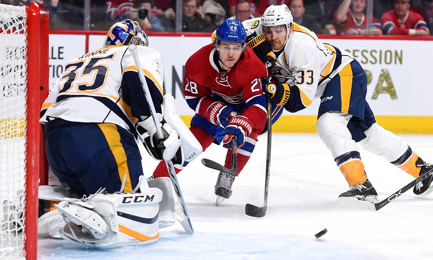 Nathan Beaulieu of the Montreal Canadiens tries to keep the puck from Colin Wilson of the Nashville Predators.