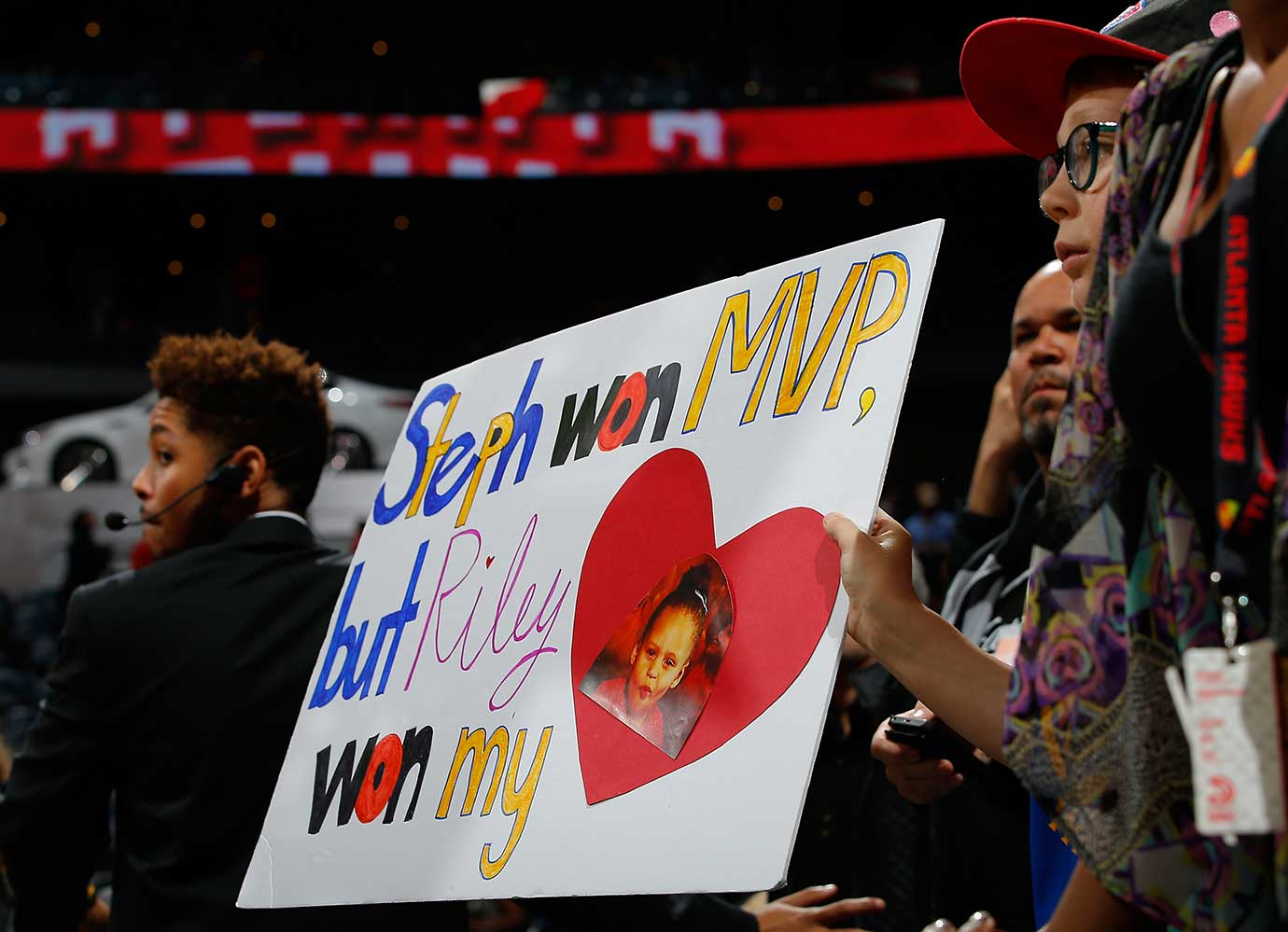 A fan holds up a sign for Stephen Curry of the Warriors after their 102-92 win over the Atlanta Hawks.