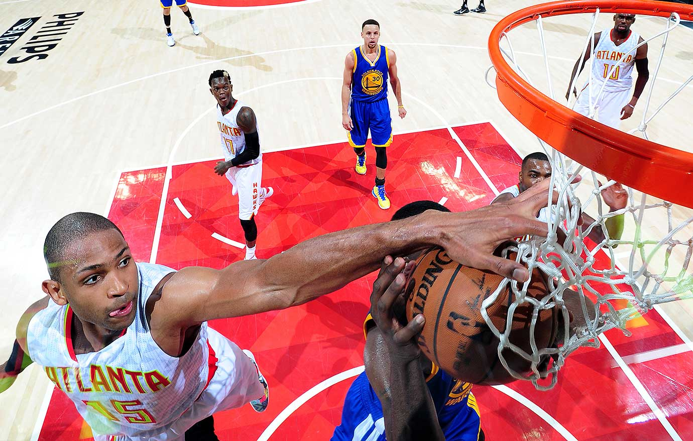 Al Horford of the Atlanta Hawks blocks a shot during the game against the Golden State Warriors in Atlanta.