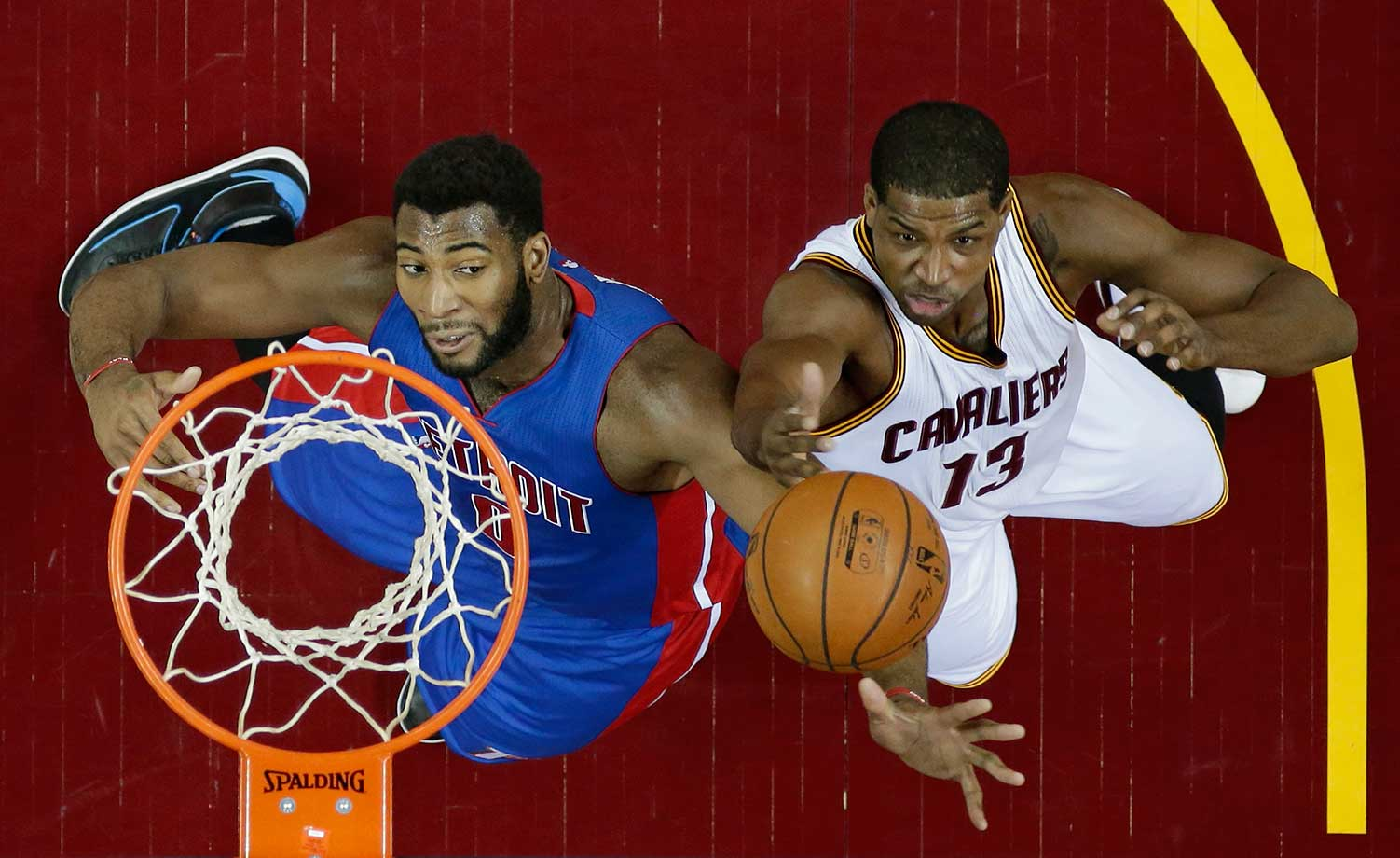 Cleveland's Tristan Thompson drives to the basket against Detroit's Andre Drummond.