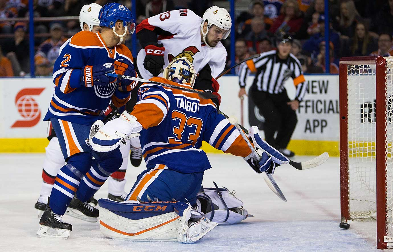 Andrej Sekera (No. 2) and goaltender Cam Talbot of Edmonton can't stop Nick Paul of Ottawa from scoring.
