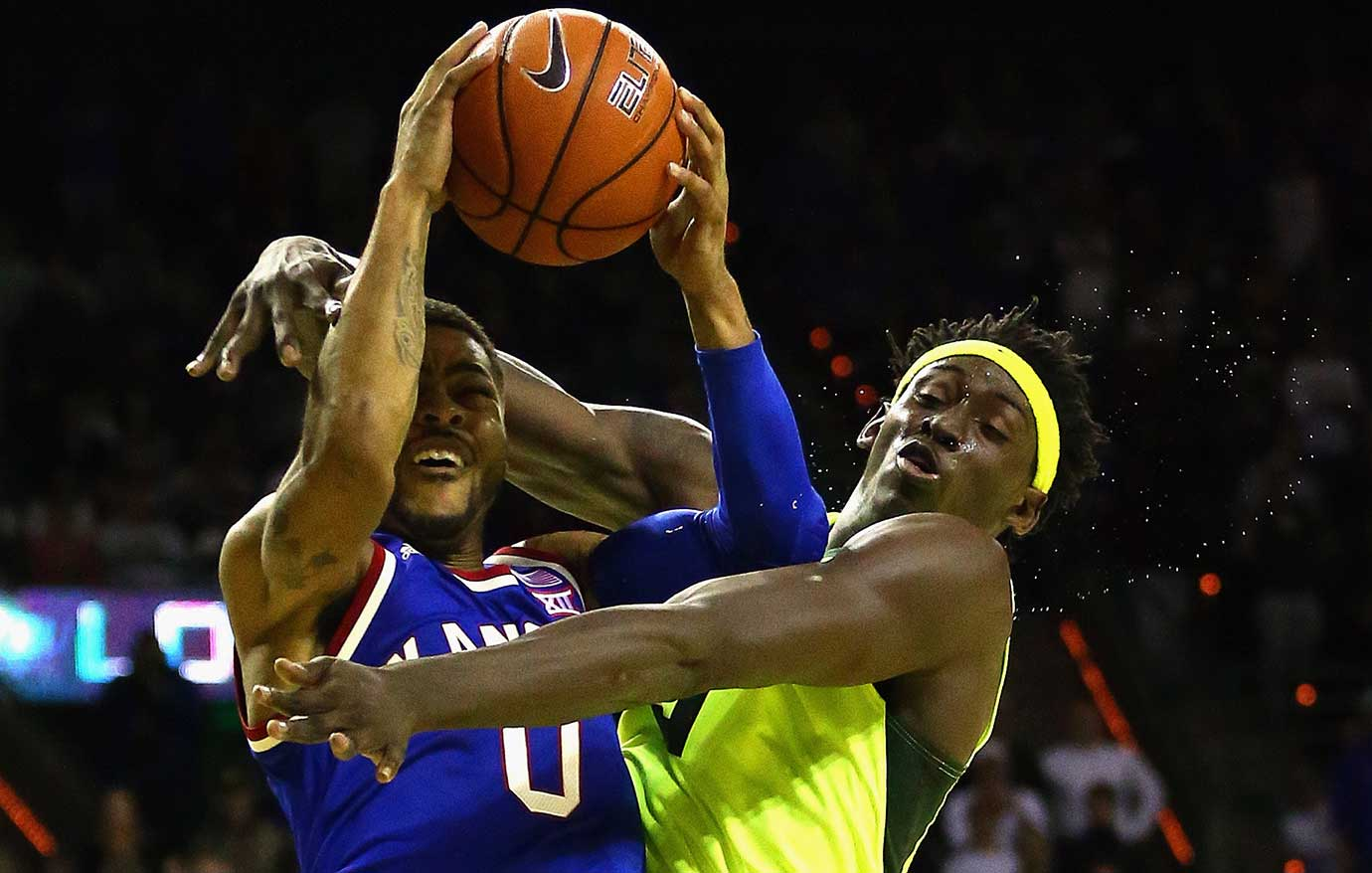 Here are some of the images that caught our eye on the sports night of Feb. 23, beginning with Frank Mason III of Kansas knocking the sweat out of Johnathan Motley of Baylor.