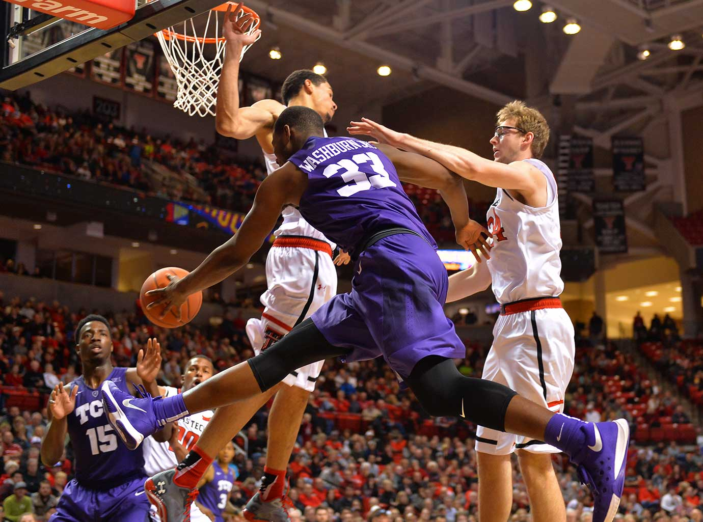Chris Washburn of the TCU Horned Frogs passes during a game against the Texas Tech Red Raiders.