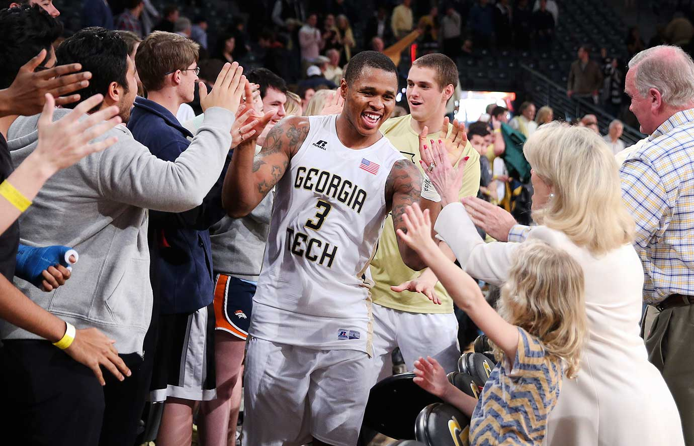 Marcus Georges-Hunt celebrates with fans after Georgia Tech won another close game, this one 75-73 over Clemson.