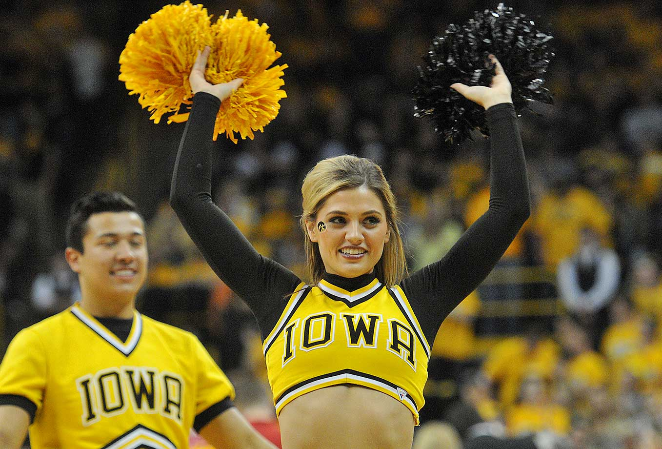 An Iowa cheerleader performs during a game between the Wisconsin Badgers and the Iowa Hawkeyes.
