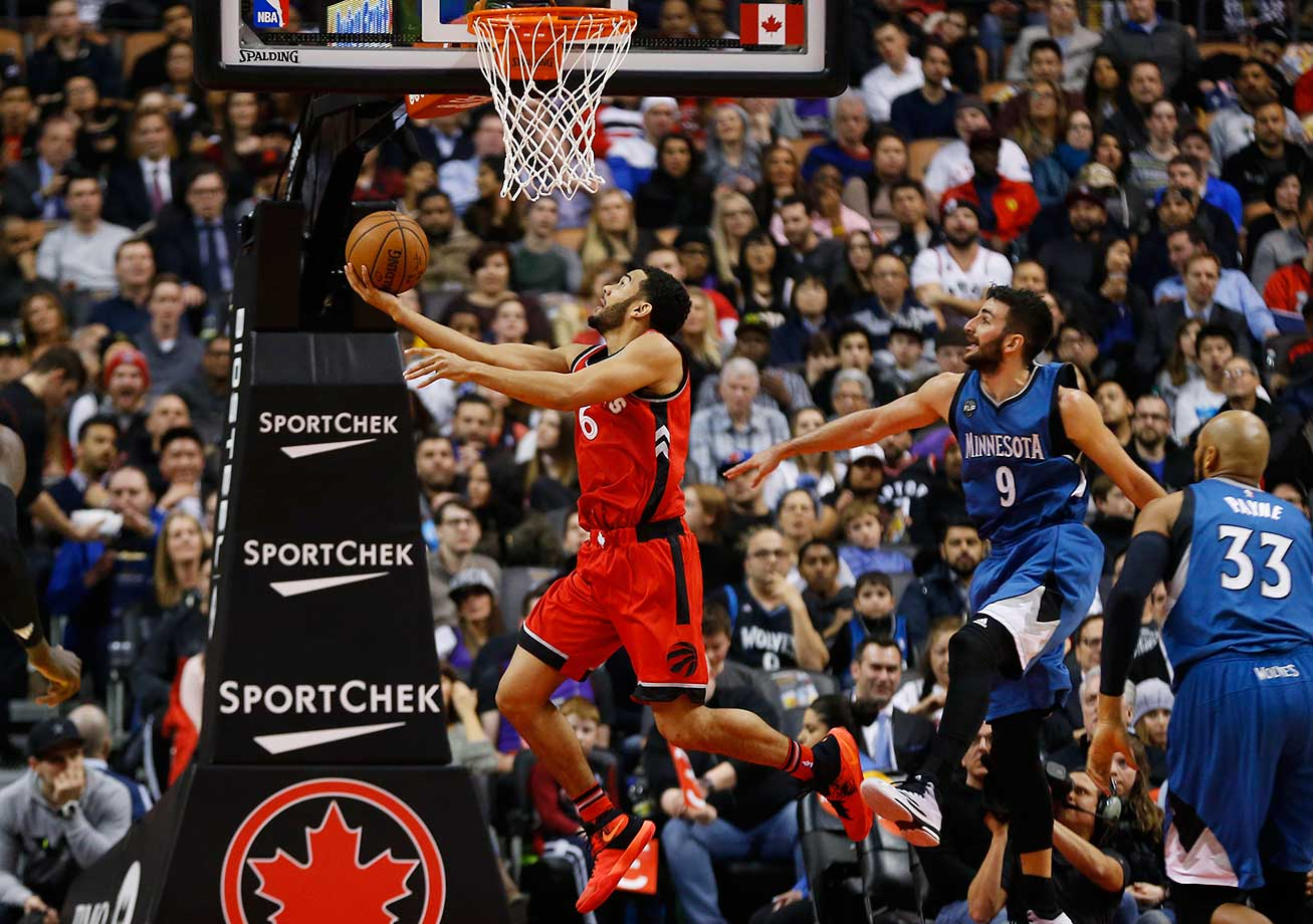 Toronto Raptors guard Cory Joseph gets past Minnesota's Ricky Rubio and Adreian Payne for a basket.