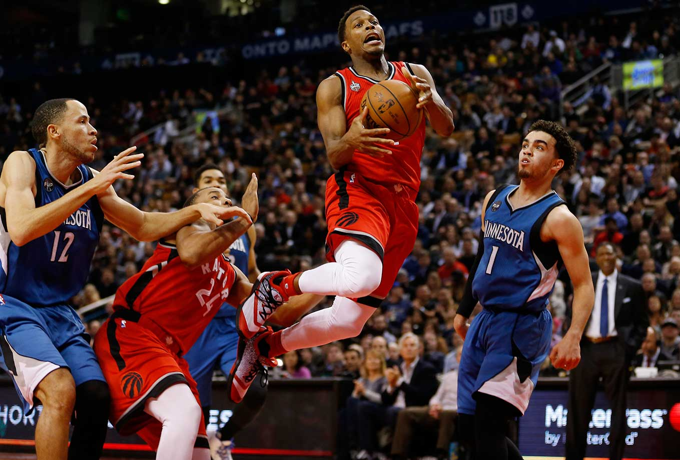 Toronto Raptors guard Kyle Lowry flies to the basket against the Minnesota Timberwolves.