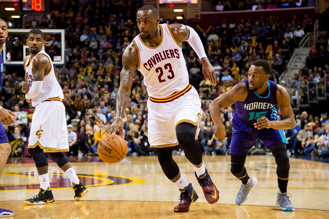 LeBron James drives around Kemba Walker of the Charlotte Hornets.
