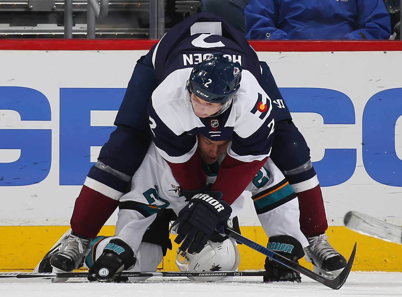 Nick Holden of the Colorado Avalanche falls on top of Joonas Donskoi of the San Jose Sharks.