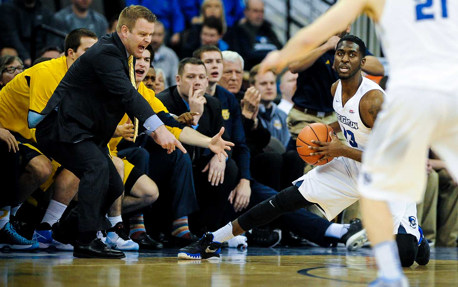 Coach Steve Wojciechowski and Marquette players reacts to a play against the Creighton Bluejays.