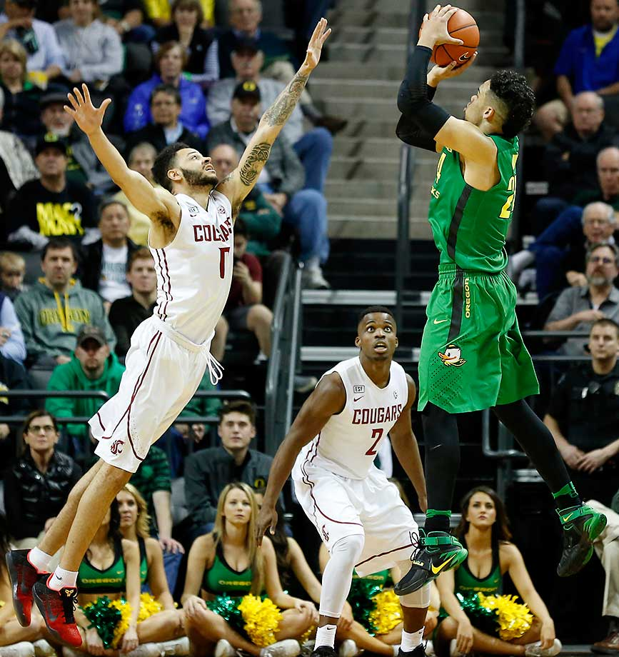 Oregon's Dillon Brooks shoots over Washington State's Derrien King in Eugene.