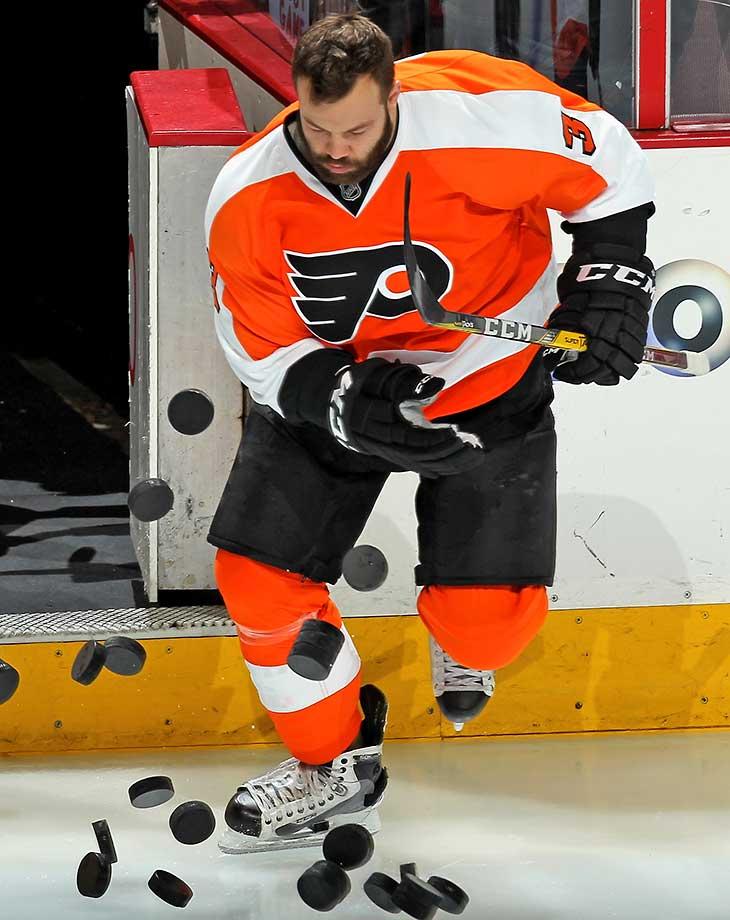 Radko Gudas of Philadelphia enters the ice surface during warmups.