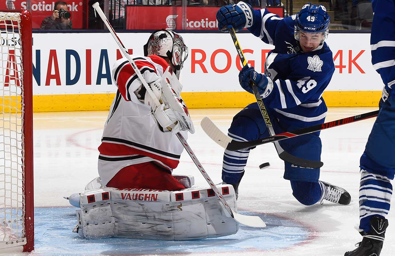 Brendan Leipsic of Toronto is stopped in close by Cam Ward of Carolina.