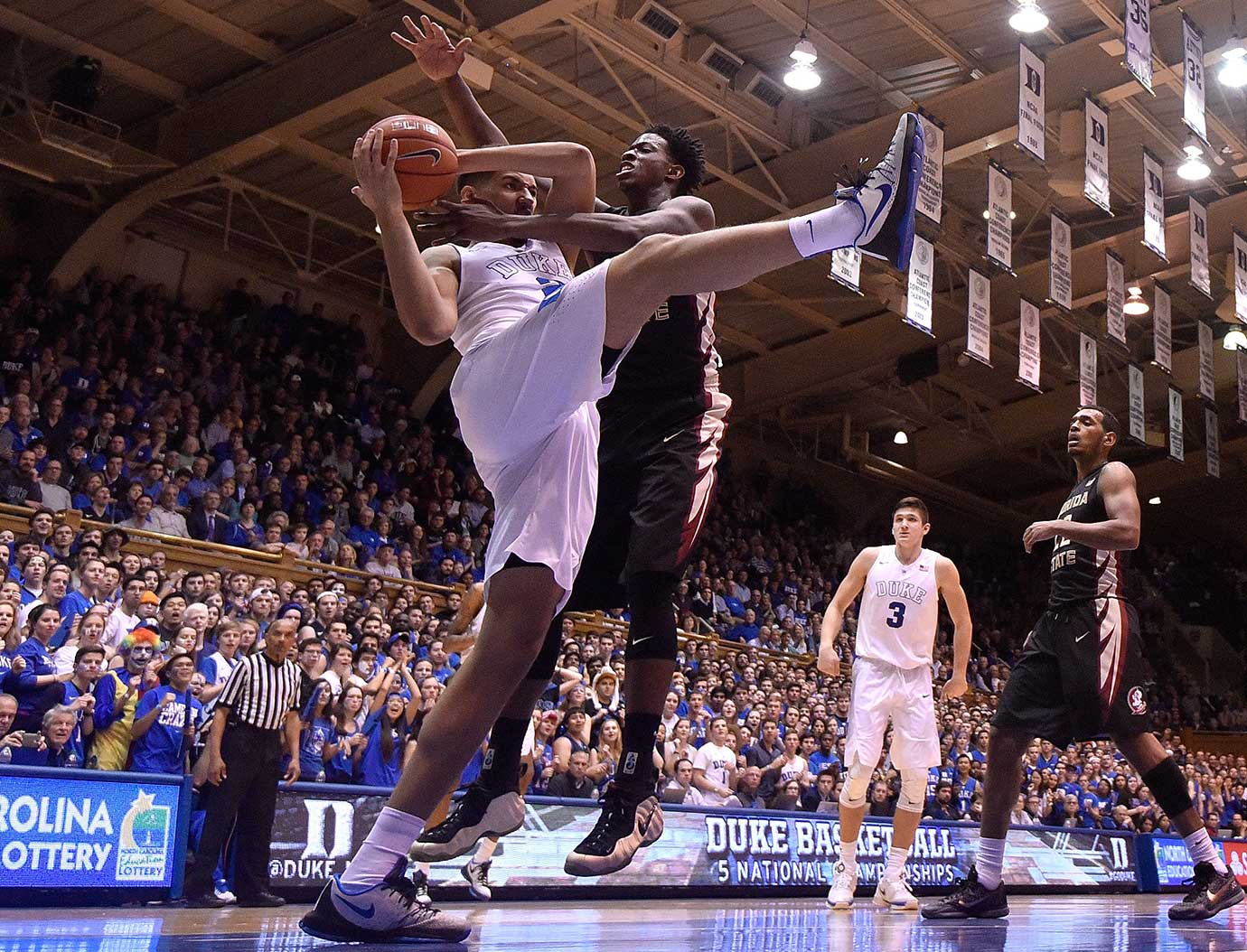 Chase Jeter of the Duke Blue Devils battles Jarquez Smith of Florida State for a rebound.