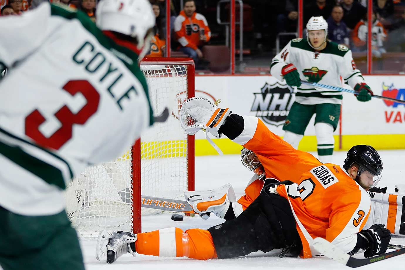 Philadelphia goaltender Michal Neuvirth makes a stick save against Charlie Coyle of Minnesota in the final seconds of a 3-2 win.