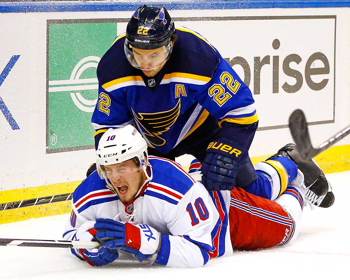 J.T. Miller of the New York Rangers is ridden to the ice after a check by Kevin Shattenkirk of St. Louis.
