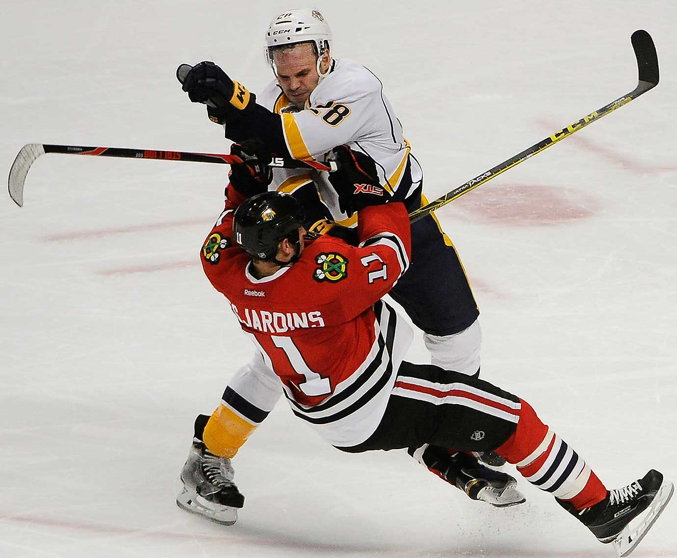 Nashville center Paul Gaustad checks Chicago Blackhawks center Andrew Desjardins.
