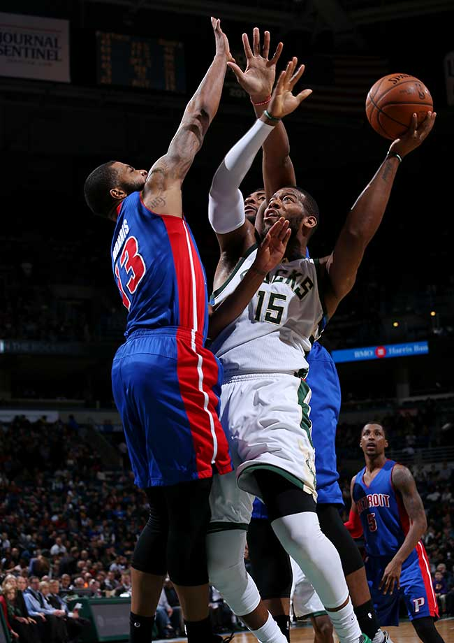 Greg Monroe of the Milwaukee Bucks shoots against the Detroit Pistons.