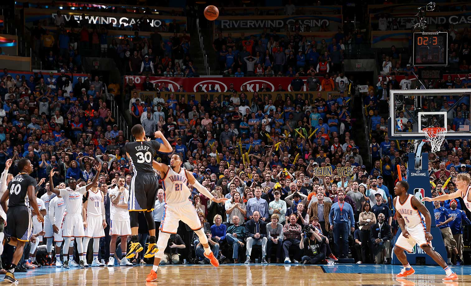 Here are some of the images that caught our eye on the sports night of Feb. 27, starting with Steph Curry's ridiculous three-pointer that lifted Golden State to an overtime win over Oklahoma City.