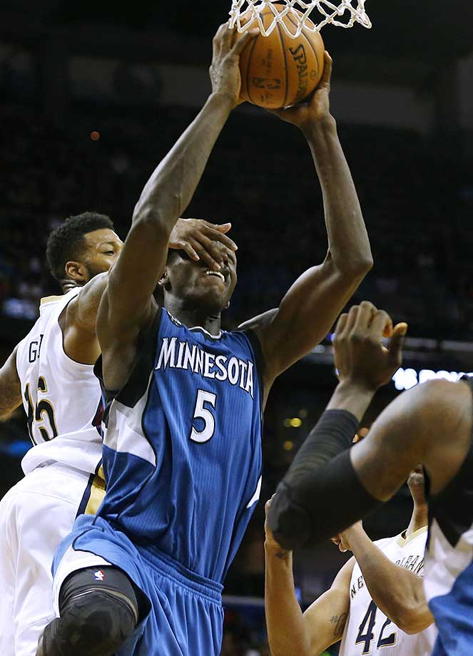 Minnesota Timberwolves center Gorgui Dieng is fouled by New Orleans Pelicans forward Alonzo Gee.