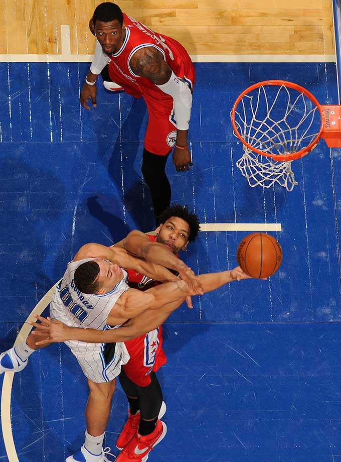 Here are some of the images that caught our eye on the sports night of Feb. 28, starting with Aaron Gordon of the Orlando Magic attempting to get up a shot.